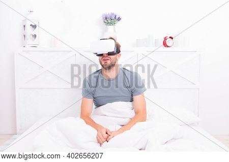 Conscious Awakening. Return To Reality. Man Explore Vr While Relaxing In Bed. Vr Technology And Futu