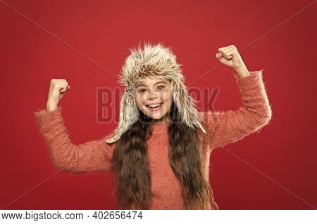 Just Glad. Caring Fur Garments. Child Long Hair Soft Hat Enjoy Softness. Winter Fashion Concept. War