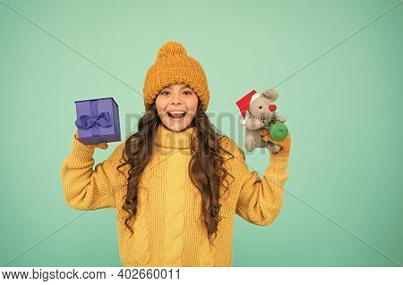 Small Girl Hold Mouse Toy And Present Box. Child Knitted Clothes Play With Toy Rat. Toy Shop For Kid