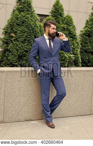 Hello Dear. Stay Connected. Businessman Talk Mobile Phone. Handsome Man With Cell Phone Outdoor. Pho