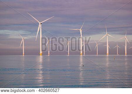 Windmills For Electric Power Production Netherlands Flevoland, Wind Turbines Farm In Sea, Windmill F
