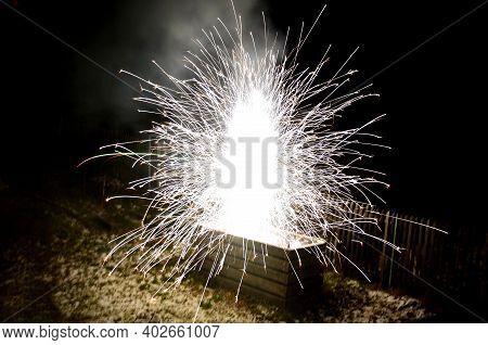 Night Explosion Crates Full Of Explosive Pyrotechnics. White Shrub Shaped White Orange Fireball With