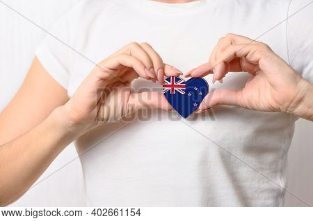 Love New Zealand. The Girl Holds A Heart In The Form Of The Flag Of New Zealand On Her Chest. New Ze