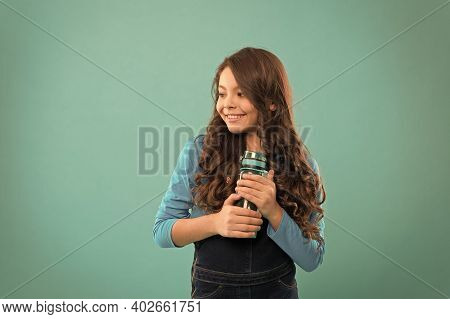 Living Healthy Life. Health And Water Balance. Girl Hold Water Bottle Blue Background. Kid Girl Long
