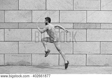 Male Runner. Man Running To Success. Sport Success. Striving For Victory. Active Man In Sport Clothi