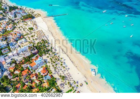 Aerial Drone View Of Beautiful Caribbean Tropical Beach With Palms And Boats. Bavaro, Punta Cana, Do