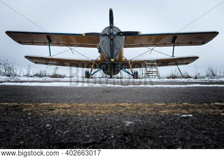 A Picture From The Airfield During The Winter. The Old Biplane Is Standing On The Runway And Waiting