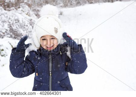 Little Girl In The Cold Winter In Warm Clothes, With Fur-lined Ear Pads. Joy, Laughter, Children's E