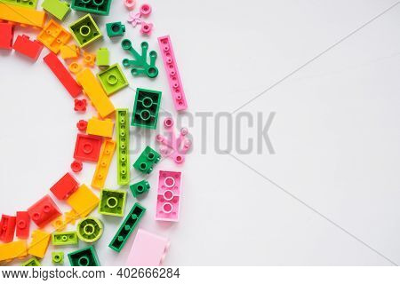 Developing Children Games Frame. Colorful Plastic Bricks And Blocks On White Background , Top View ,