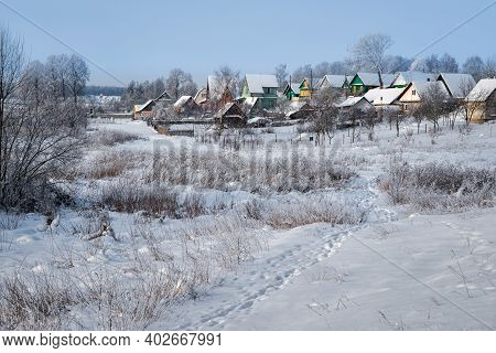 Village In A Winter Day And Snow. Russia