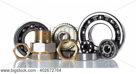 Machinery And Technology Industrial Background. Group Of Various Ball Bearings With Nuts Close Up Is
