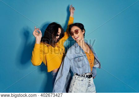Two Happy Excited Pretty Stylish Cool Diverse Gen Z Girls Friends Wearing Glasses, Trendy Sunglasses