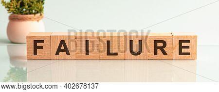 Failure Word Written On Wood Block. Failure Motivation Text On Wooden Blocks, Flower In The Backgrou