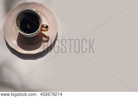 Breakfast Still Life Scene. Black Coffee In Pink Golden Glittering Porcelain Cup. Neutral Champagne