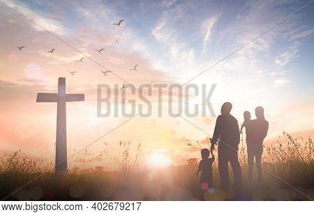 Easter Sunday Concept: Silhouette Family Looking For The Cross Of Jesus Christ On Autumn Sunrise Bac