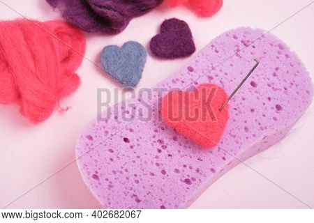 Hearts Made Of Wool, Needles For Felting, A Sponge And Skeins Of Wool, The Process Of Felting From W