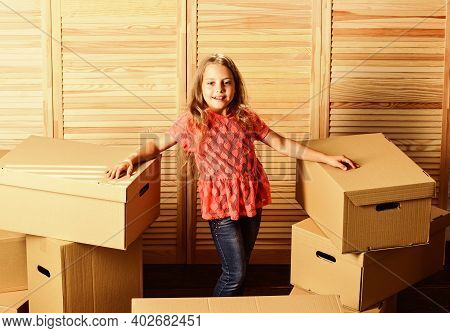Finally. Happy Child Cardboard Box. Purchase Of New Habitation. Cardboard Boxes - Moving To A New Ho