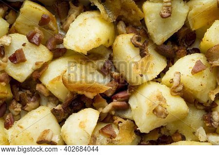 Close Up Of Rustic Baked Potatoes And Bacon Food Background