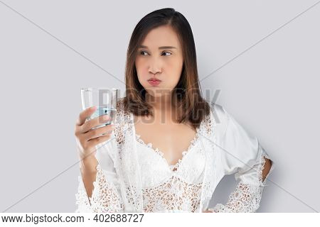 Woman Rinsing Your Mouth With Mouthwash After Brushing After Waking Up To Start Your Mornings. Denta