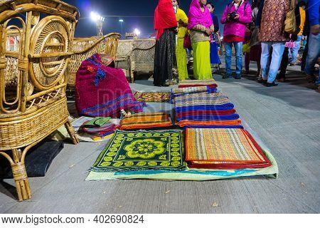 Kolkata, West Bengal, India - 31st December 2018 : Woman Seller Resting While Selling Woolen Carpets