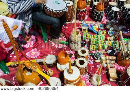 Kolkata, West Bengal, India - 31st December 2018 : Indian Man Selling Various Musical Instruments To