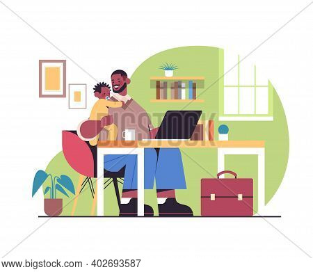 African American Father Sitting At Workplace With Little Son Fatherhood Parenting Concept Dad Spendi