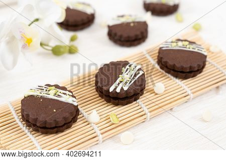 Circular Chocolate Sandwich Biscuit Cookies With Dark Chocolate Cream Filling