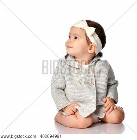 Happy Smiling Curious Child In Knitted Clothes, Headband Isolated Portrait. Excited Infant Child Loo