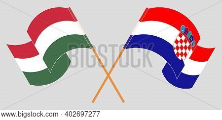 Crossed And Waving Flags Of Croatia And Hungary. Vector Illustration
