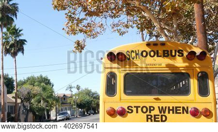 Yellow Iconic School Bus In Los Angeles, California Usa. Classic Truck For Students Back View. Vehic