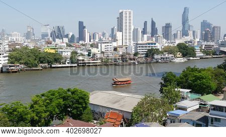 Financial District Near Calm River. View Of Skyscrapers Located On Shore Of Tranquil Chao Praya Rive