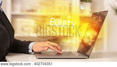 Closeup of businessman hands working on laptop with EQUITY inscription, succesfull business concept