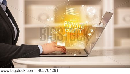Side view of a business person working on laptop with PRIVATE EQUITY inscription, modern business concept
