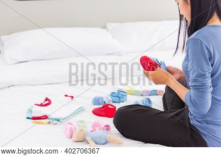 Asian Mother Preparing Baby Clothes Resting And Relaxing On The Bed She Makes Purchase New Baby Clot