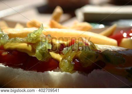 Hot Dog With Mustard, Ketchup, Relish, Illuminated By Sunlight. Fast Food.