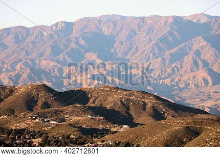 Sun Setting On Arid Hills And Mountainous Terrain Beyond Creating Natural Shadows Taken At The Rural