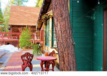 Retail Stores With Outdoor Patio Seating Surrounded By An Alpine Pine Forest Taken In The Resort Mou