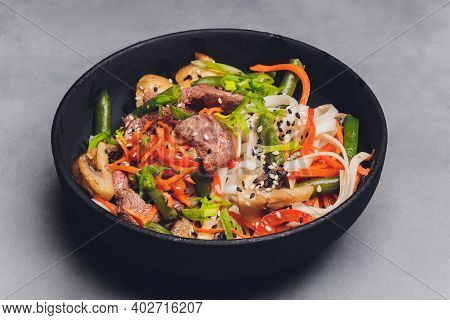 Udon Noodles With Chicken And Peppers - Japanese Cuisine.