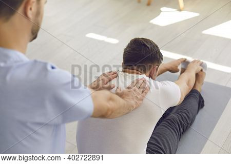 Man Professional Doctor Osteopath Fixing And Stretching Mans Back During Exersicing