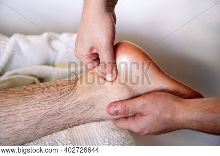 Massage Relax Studio. Foot Massage. Close Up Of Foot Receiving Massage In Spa Salon. Man Receives Le