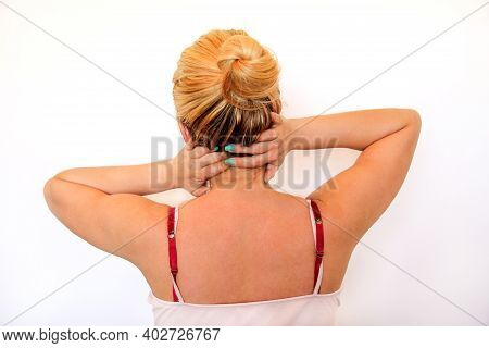 Neck Pain. Tired Woman Having Pain In Neck, Rubbing It. Massage Of The Shoulder And Neck. Pain In Th