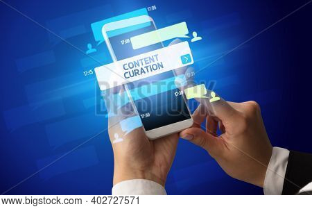 Female hand typing on smartphone with CONTENT CURATION inscription, social networking concept