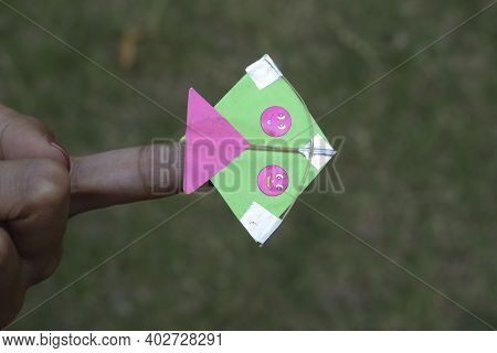 Small Miniature Cute Kite On Index Finger, Size Of A Finger Tiny Kite Patang With Smiley Design. Var