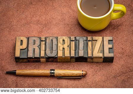 prioritize - motivational word abstract in vintage letterpress wood type with a cup of coffee, business or lifestyle concept