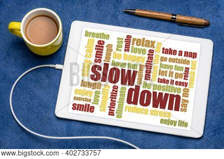 slow down and relax - reducing stress tips in a form of a word cloud on a digital tablet with a cup of coffee, healthy lifestyle concept