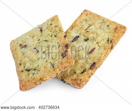 Salted Crackers Isolated On White Background. Crushed Dry Cracker Cookies With Herbs, Top View