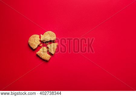 Heartbroken Cookies On Red Background, Valentines Day Concept