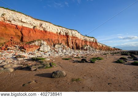 Hunstanton Cliffs In North Norfolk England Viewed From The Beach. March 2017. These Eroding Cliffs E