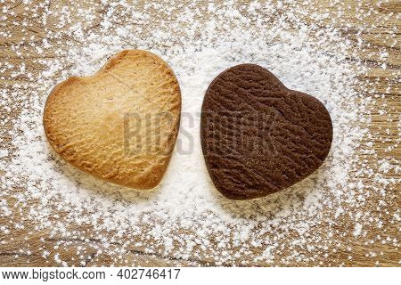Two Heart Shaped Cookies On Wooden Background. Baked Butter And Chocolate Cookies. Valentines Day Co