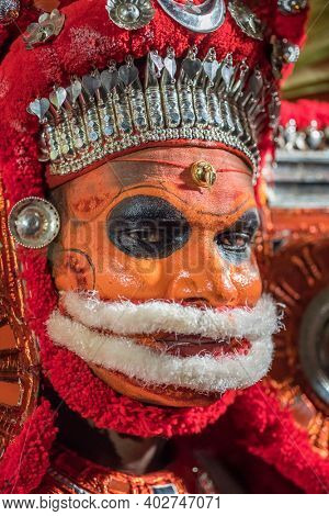 Payyanur, India - December 5, 2019: Portrait of an unidentified Theyyam dancer during temple festival in Payyanur, Kerala, India. Theyyam is a popular ritual form of worship in Kerala, India